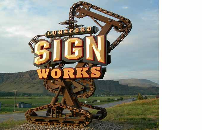 Sign works sign built with adhesives